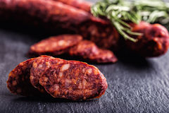 Sausage Chorizo. Spanish traditional chorizo sausage, with fresh herbs, garlic, pepper and chili peppers. Traditional cuisine Royalty Free Stock Images