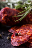 Sausage Chorizo. Spanish traditional chorizo sausage, with fresh herbs, garlic, pepper and chili peppers. Traditional cuisine Royalty Free Stock Photography