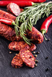 Sausage Chorizo. Spanish traditional chorizo sausage, with fresh herbs, garlic, pepper and chili peppers. Traditional cuisine Stock Images