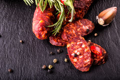 Sausage Chorizo. Spanish traditional chorizo sausage, with fresh herbs, garlic, pepper and chili peppers. Traditional cuisine Stock Photos