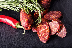 Sausage Chorizo. Spanish traditional chorizo sausage, with fresh herbs, garlic, pepper and chili peppers. Traditional cuisine Stock Photo