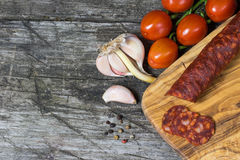 Sausage Chorizo, tomatoes and garlic on the wooden desk Stock Photo