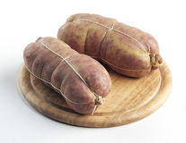 Sausage Cotechino on cutting board Stock Photos