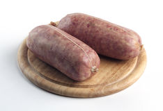 Sausage Cotechino on cutting board Royalty Free Stock Photos