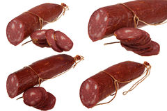 Sausage and cut slices Stock Photos