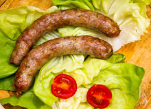 Sausage on cutting board top Royalty Free Stock Photo
