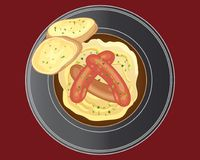 Sausage dinner with buttered bread on a red background Royalty Free Stock Photography