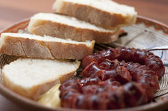 Sausage dish. Fried sausage in close up mode in a plate stock photos