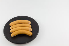 Sausage on dish. Stock Image