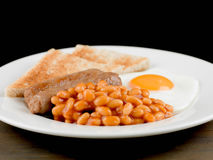 Sausage Egg and Baked Beans Cooked English Breakfast Royalty Free Stock Photos