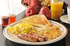 Sausage and egg breakfast Stock Images