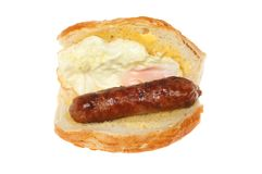 Sausage and egg roll. Fried egg and sausage in a bread roll isolated against white Stock Images