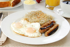 Sausage and eggs Stock Images