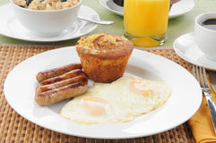 Sausage and eggs with coffee cake Royalty Free Stock Photo