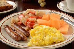 Sausage and eggs with homefries Stock Photos