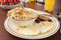 Sausage and eggs with oatmeal Royalty Free Stock Photo