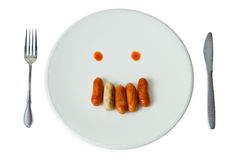 Sausage face on white dish Stock Image