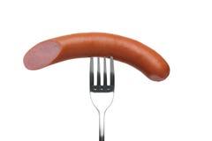 Sausage on fork Stock Photography