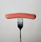Sausage on the fork Stock Photos