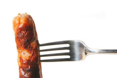 Sausage on fork Royalty Free Stock Photo