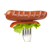 Sausage on a fork Stock Photography