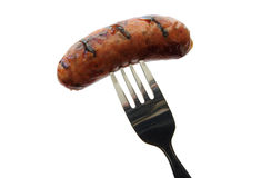 Sausage on a fork Stock Images
