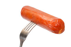 Sausage on the fork Royalty Free Stock Photography