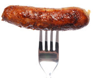 Sausage on fork Stock Images