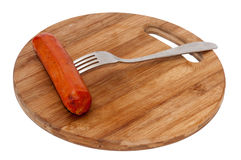 Sausage on the fork Royalty Free Stock Photos