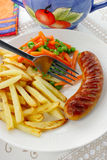 Sausage with french fries Stock Photo