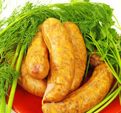Sausage and Fresh Dill, parsley Stock Photos