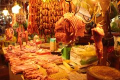 Meat market Cambodia. Sausage and fresh meat are sold by the butcher at the Siem Reap market in Cambodia Royalty Free Stock Image