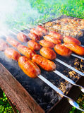 Sausage fried on a barbecue brazier Royalty Free Stock Image