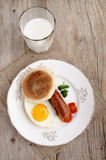 Sausage and fried egg on a plate Royalty Free Stock Images