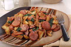 Sausage and Fried Potatoes Stock Photography