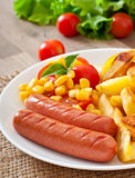 Sausage with fried potatoes and vegetables Royalty Free Stock Photography