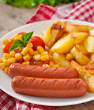 Sausage with fried potatoes and vegetables Royalty Free Stock Image