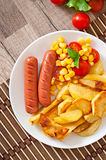 Sausage with fried potatoes and vegetables Stock Photography