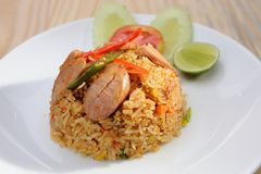Sausage fried rice on white dish Stock Photo