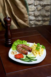 Sausage with fries. And vegetables Royalty Free Stock Photography