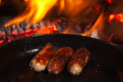 Sausage in Frying Pan Royalty Free Stock Photo