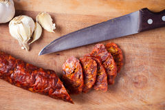 Sausage, garlic and knife Royalty Free Stock Photos