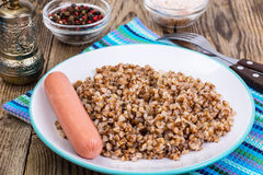 Sausage with garnish of buckwheat Stock Images