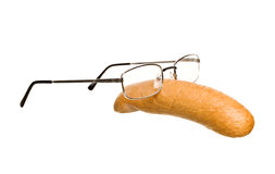 Sausage with glasses Royalty Free Stock Images