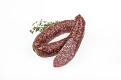 Sausage With Greenery. On an isolated studio background Stock Image