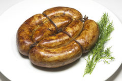 Sausage with greens Royalty Free Stock Image