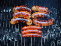 Sausage on the grill. Pork sausage and hot dogs on the grill Royalty Free Stock Photos