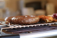 Sausage on grill royalty free stock photography