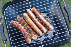 Sausage on a grill Royalty Free Stock Image