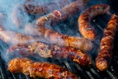Sausage on the grill. Hot sausage on the grill royalty free stock photos
